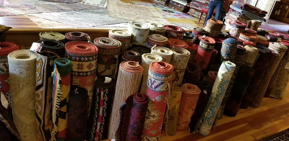 rolled and laid rugs from Istanbul Rug Bazaar, here at the Belfry